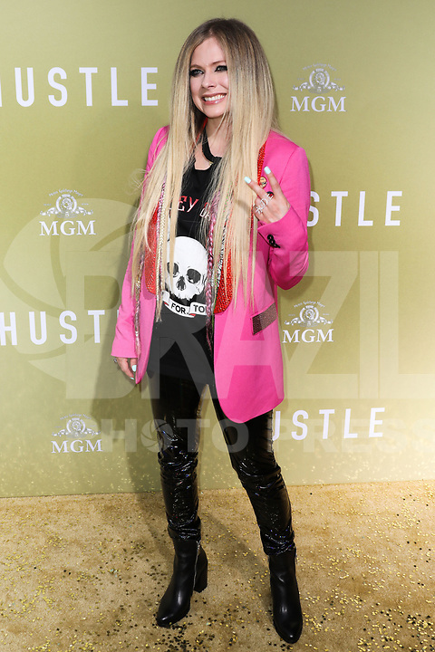 Singer Avril Lavigne arrives at the Los Angeles Premiere Of MGM's 'The Hustle' held at ArcLight Cinerama Dome on May 8, 2019 in Hollywood, Los Angeles, California, United States.