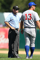Umpire Brett Houseman listens to Casey Kopitzke during a game at Elfstrom Stadium in Geneva, Illinois;  August 15, 2010.  Photo By Mike Janes/Four Seam Images