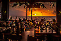 Travel Print Photograph of a golden sunset viewed from a restaurant along the ocean in Banderas Bay, Puerto Vallarta, Mexico.<br /> A romantic restaurant scene of a beautiful golden sunset with low key detailed shadows of the people, tables, and chairs that add character and mood to the scene.