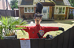 SCARECROW VILLAGE FESTIVAL IN HORDLE, HAMPSHIRE.<br /> <br /> Pictured: Postman Pat - Entry No.7 for the Hordle Scarecrow compeition.<br /> <br /> Entries this year to a village scarecrow competition seem to have taken a Covid-19 theme, with entries showing Dominic Cummings holding a steering wheel next to an eye chart, key workers stood 2 metres apart and politicians stood at lecterns.<br /> <br /> The pandemic appears to have also played a part in the number of entries this year which is down from twenty last year to eight, but families and businesses have still produced a range of scarecrows for the competition.<br /> <br /> The competition this year is raising money for PATCH - Parents and Teachers in the Community of Hordle, and is organised by the Hordle and District Twinning Association.<br /> <br /> © Ewan Galvin/Solent News & Photo Agency<br /> UK +44 (0) 2380 458800
