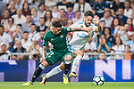 Isco Alarcon (r) of Real Madrid fights for the ball with Arnaldo Antonio Sanabria Ayala of Real Betis during the La Liga 2017-18 match between Real Madrid and Real Betis at Estadio Santiago Bernabeu on 20 September 2017 in Madrid, Spain. Photo by Diego Gonzalez / Power Sport Images