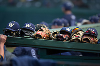 Baseball gloves and caps are lined up on top of the Wingate Bulldogs dugout during the game against the Catawba Indians at Newman Park on March 19, 2017 in Salisbury, North Carolina. The Indians defeated the Bulldogs 12-6. (Brian Westerholt/Four Seam Images)