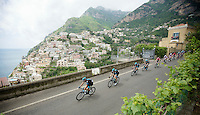 2013 Giro d'Italia .stage 03..peloton driving by the sea.