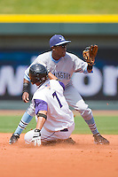 Juan Rivera #9 of the Wilmington Blue Rocks waits for the throw as Luis Sierra #7 of the Winston-Salem Dash slides into second base with a double at the BB&T Park April25, 2010, in Winston-Salem, North Carolina.  Photo by Brian Westerholt / Four Seam Images