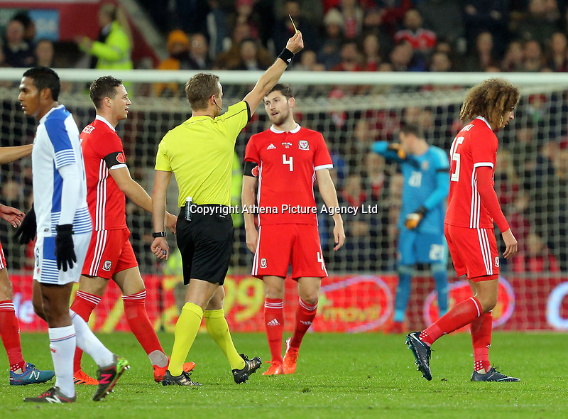 Referee Bart Vertenten shows a yellow card to Ethan Ampadu of Wales (R) for his foul on Gabriel Torres of Panama during the international friendly soccer match between Wales and Panama at Cardiff City Stadium, Cardiff, Wales, UK. Tuesday 14 November 2017.