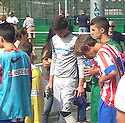 """Collect pic of Josuha Rae, who is 6' 1"""" despite only being 12 years old (white top), before he plays one of his games during his trial with Atletico de Madrid.."""