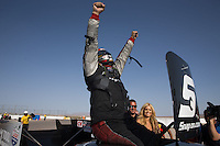 Apr. 7, 2013; Las Vegas, NV, USA: NHRA funny car driver Cruz Pedregon celebrates after winning the Summitracing.com Nationals at the Strip at Las Vegas Motor Speedway. Mandatory Credit: Mark J. Rebilas-