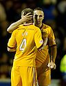 MOTHERWELL'S NICKY LAW IS CONSOLED AFTER HIBS KEEPER  MARK BROWN SAVES HIS PENALTY TO PUT HIBS THROUGH