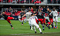 WASHINGTON, DC - FEBRUARY 29: Ulises Segura #8 of DC United clears from Drew Moor #3 of the Colorado Rapids during a game between Colorado Rapids and D.C. United at Audi Field on February 29, 2020 in Washington, DC.