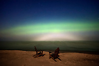 Aurora and full moon bow over Lake Superior