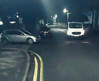 """Pictured: Police stop a Vauxhall Astra with four people on a ghost-hunt in Mumbles near Swansea, Wales, UK. Friday 05 March 2021<br /> Re: Four people on a ghost hunt 60 miles away from home have been fined by police for breaking lockdown rules in Mumbles near SWansea, Wales, UK.<br /> Covid fixed penalties were issued to them for driving from Cwmbran in Torfaen to Mumbles, Swansea, to """"ghost hunt and view castles"""".<br /> A car was also seized due to the driver having no insurance and only a provisional licence.<br /> Current lockdown rules in Wales say you can only travel when essential.<br /> South Wales Police tweeted it would be a """"long walk home"""" for offenders."""