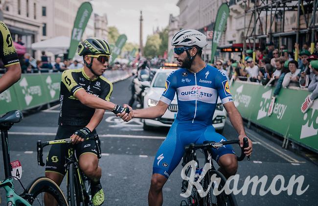 a gentlemens pre-race handshake between sprinters Caleb Ewan (AUS/Mitchelton Scott) & Fernando Gaviria (COL/Quick-Step Floors)<br /> <br /> Stage 8: London to London (77km)<br /> 15th Ovo Energy Tour of Britain 2018