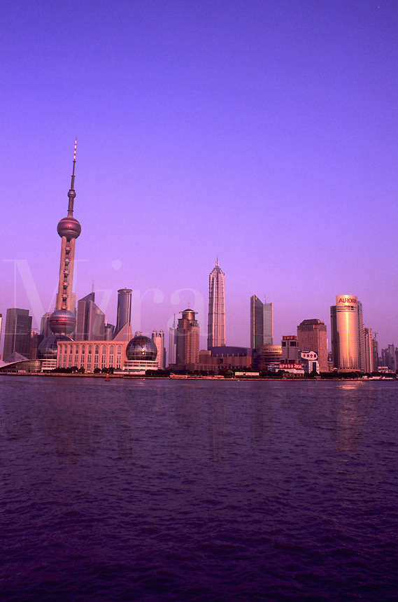 Shanghai China wonderful skyline with modern skyscrapers by river with sunset pink colors in China