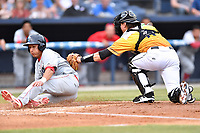 Beer City Tourists catcher Robbie Perkins (11) tags out Carlos Duran (13) during a game against the Lakewood BlueClaws at McCormick Field on June 1, 2017 in Asheville, North Carolina. The Tourists defeated the BlueClaws 8-5. (Tony Farlow/Four Seam Images)