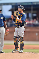 Columbia Fireflies catcher Tyler Moore (21) discusses signals with Gaby Almonte (40) during a game against the Asheville Tourists at McCormick Field on June 17, 2016 in Asheville, North Carolina. The Tourists defeated the Fireflies 6-2. (Tony Farlow/Four Seam Images)