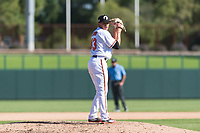 Glendale Desert Dogs relief pitcher Tyler Erwin (43), of the Baltimore Orioles organization, gets ready to deliver a pitch during an Arizona Fall League game against the Mesa Solar Sox at Camelback Ranch on October 15, 2018 in Glendale, Arizona. Mesa defeated Glendale 8-0. (Zachary Lucy/Four Seam Images)