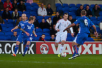 Wednesday 05 March 2014<br /> Pictured: Gareth Bale moves forwards  surrounded by Icelandic players<br /> Re: International friendly Wales v Iceland at the Cardiff City Stadium, Cardiff,Wales UK