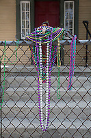 New Orleans, Louisiana.  Beaded Necklaces on Chain-link Fence after Mardi Gras.  Uptown District.