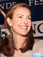 Montreal, 1999-08-30. Carole Bouquet, press conference at Montreal World Film Festival<br /> <br /> Carole Bouquet (born 18 August 1957) is a French actress and fashion model. Bouquet was born in Neuilly-sur-Seine, France.<br /> <br /> She is best known internationally as Bond girl Melina Havelock in the 1981 movie For Your Eyes Only, although she featured in a number of mainstream European films throughout the 1980s and continued to do so up until 2005 in France.<br /> <br /> She is also recognized for her work in Luis Buñuel's surrealist classic That Obscure Object of Desire (1977), and in the internationally successful film Too Beautiful For You (1989).<br /> <br /> Bouquet was a model for Chanel in the 1990s. She is the widow of producer Jean-Pierre Rassam with whom she had a son, Dimitri Rassam. From 1997 to 2005, she dated actor Gerard Depardieu, with whom she had worked several times. Bouquet was engaged to him from 2003 to 2005.