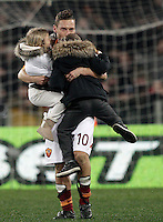 Calcio, Serie A: Roma vs Genoa. Roma, stadio Olimpico, 3 marzo 2013..AS Roma forward Francesco Totti kisses his children Chanel, left, and Cristian, at the end of the Italian Serie A football match between AS Roma and Genoa at Rome's Olympic stadium, 3 March 2013..UPDATE IMAGES PRESS/Riccardo De Luca