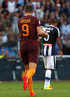 Calcio, Serie A: Roma vs Udinese. Roma, stadio Olimpico, 20 agosto 2016.<br /> Roma's Edin Dzeko celebrates after scoring during the Italian Serie A football match between Roma and Udinese at Rome's Olympic Stadium, 20 August 2016. Roma won 4-0.<br /> UPDATE IMAGES PRESS/Riccardo De Luca