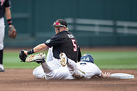 Texas Tech Red Raiders second baseman Brian Klein (5) attempts to tag our a baserunner during Game 1 of the NCAA College World Series against the Michigan Wolverines on June 15, 2019 at TD Ameritrade Park in Omaha, Nebraska. Michigan defeated Texas Tech 5-3. (Andrew Woolley/Four Seam Images)