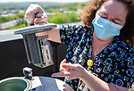 WATERBURY, CT 050621JS33—Franca Hahn, a clinical laboratory scientist at Waterbury Hospital, explains how the hospital collects pollen samples from the unit on their roof on Thursday. <br /> Jim Shannon Republican American