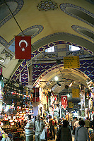 Arched ceiling and wares on display at the Grand Bazaar, Istanbul, Turkey.