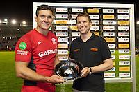 130712 Copyright onEdition 2012 ©.Free for editorial use image, please credit: onEdition..Nils Mordt, captain of Saracens, receives the plate for winning team from J.P.Morgan CEO Roger Thompson at The Stoop, Twickenham in the first round of The J.P. Morgan Asset Management Premiership Rugby 7s Series...The J.P. Morgan Asset Management Premiership Rugby 7s Series kicked off again for the third season on Friday 13th July at The Stoop, Twickenham with Pool B being played at Edgeley Park, Stockport on Friday, 20th July, Pool C at Kingsholm Gloucester on Thursday, 26th July and the Final being played at The Recreation Ground, Bath on Friday 3rd August. The innovative tournament, which involves all 12 Premiership Rugby clubs, offers a fantastic platform for some of the country's finest young athletes to be exposed to the excitement, pressures and skills required to compete at an elite level...The 12 Premiership Rugby clubs are divided into three groups for the tournament, with the winner and runner up of each regional event going through to the Final. There are six games each evening, with each match consisting of two 7 minute halves with a 2 minute break at half time...For additional images please go to: http://www.w-w-i.com/jp_morgan_premiership_sevens/..For press contacts contact: Beth Begg at brandRapport on D: +44 (0)20 7932 5813 M: +44 (0)7900 88231 E: BBegg@brand-rapport.com..If you require a higher resolution image or you have any other onEdition photographic enquiries, please contact onEdition on 0845 900 2 900 or email info@onEdition.com.This image is copyright the onEdition 2012©..This image has been supplied by onEdition and must be credited onEdition. The author is asserting his full Moral rights in relation to the publication of this image. Rights for onward transmission of any image or file is not granted or implied. Changing or deleting Copyright information is illegal as specified in the Copyright, Design and Patents Act 1988. If you are in any way unsure