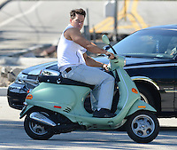 SMG_FLXX_Mark Wahlberg_Vespa_042512_01.JPG<br /> <br /> MIAMI BEACH, FL - APRIL 25:  Mark Wahlberg on the set of Pain and Gain which is directed by Michael Bay. Pain and Gain is about a  pair of bodybuilders in Florida get caught up in an extortion ring and a kidnapping scheme that goes terribly wrong. on April 25, 2012 in Miami Beach, Florida. (Photo By Storms Media Group)     <br /> <br /> People:  Mark Wahlberg<br /> <br /> Transmission Ref:  FLXX<br /> <br /> Must call if interested<br /> Michael Storms<br /> Storms Media Group Inc.<br /> 305-632-3400 - Cell<br /> 305-513-5783 - Fax<br /> MikeStorm@aol.com