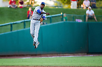 Hector Gomez (5) of the Tulsa Drillers makes a leaping throw to first during a game against the Springfield Cardinals at Hammons Field on July 18, 2011 in Springfield, Missouri. Tulsa defeated Springfield 13-8. (David Welker / Four Seam Images)