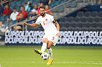KANSASCITY, KS - JULY 11: Steven Vitoria #5 of Canada passes the ball during a game between Canada and Martinique at Children's Mercy Park on July 11, 2021 in KansasCity, Kansas.
