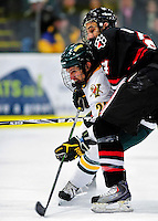 26 November 2010: University of Vermont Catamount forward Brett Leonard, a Senior from South Burlington, VT, is checked by forward Drew Daniels, a Sophomore from Suffern, NY, during a game against the Northeastern University Huskies at Gutterson Fieldhouse in Burlington, Vermont. The Huskies came back from a 2-0 deficit to earn a 2-2 tie against the Catamounts. Mandatory Credit: Ed Wolfstein Photo