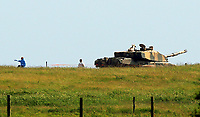 Thursday 15 June 2017<br /> Pictured: Men in forensics suits examine a tank, believed to be the one involved in the fatal incident in Castlemartin range.<br /> Re: A soldier has been killed and three others injured after an incident involving a tank at a Ministry of Defence base in Pembrokeshire.<br /> The soldier, from the Royal Tank Regiment, died in the incident at Castlemartin Range.<br /> Two people were taken to Morriston Hospital in Swansea, while another casualty remains in Cardiff's University Hospital of Wales.<br /> An investigation is under way.<br /> Live firing was scheduled to take place at the range between Monday and Friday.<br /> In May 2012, Ranger Michael Maguire died during a live firing exercise at the training base. An inquest later found he was unlawfully killed.