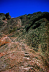 Hand carved by the Civilian Conservation Corps, a granite stairway nears the peak of Pinnacles National Monument in California.  Hand rail at top!