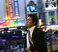 A Japanese businessman in the up-market shopping district,  Ginza, Tokyo, Japan.<br /> April-2014