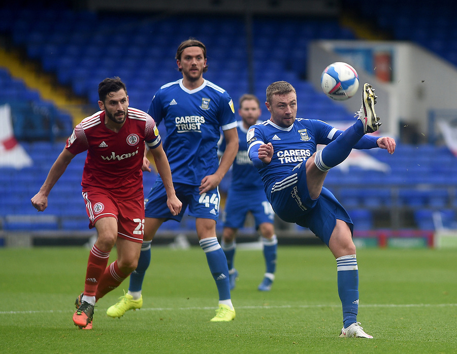 Ipswich Town's Freddie Sears with the ball as Accrington Stanley's Seamus Conneely looks on<br /> <br /> Photographer Hannah Fountain/CameraSport<br /> <br /> The EFL Sky Bet League One - Ipswich Town v Accrington Stanley - Saturday 17th October 2020 - Portman Road - Ipswich<br /> <br /> World Copyright © 2020 CameraSport. All rights reserved. 43 Linden Ave. Countesthorpe. Leicester. England. LE8 5PG - Tel: +44 (0) 116 277 4147 - admin@camerasport.com - www.camerasport.com