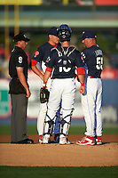 Reading Fightin Phils pitching coach David Lundquist (55) talks with pitcher Nick Pivetta (40) and catcher Andrew Knapp (10) as umpire Paul Clemons listens in during a game against the New Britain Rock Cats on August 7, 2015 at FirstEnergy Stadium in Reading, Pennsylvania.  Reading defeated New Britain 4-3 in ten innings.  (Mike Janes/Four Seam Images)