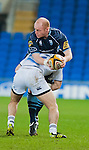 Martyn Williams of the Cardiff Blues is tackled in the magners league match against Leinster.