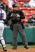 Home plate umpire Jeff Gosney throws a ball to the pitcher during a game between the Buffalo Bisons and Pawtucket Red Sox at Coca-Cola Field on April 15, 2012 in Buffalo, New York.  Buffalo defeated Pawtucket 10-9 in ten innings.  (Mike Janes/Four Seam Images)