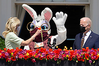 US President Joe Biden (R) watches First Lady Jill Biden (L) give the Easter bunny a flower after he delivered remarks regarding Easter, on the Truman Balcony at the South Lawn of the White House, in Washington, DC, USA, 05 April 2021. The traditional Easter Egg Roll at the White House with thousands of visitors was not held due to the coronavirus COVID-19 pandemic.<br /> Credit: Michael Reynolds / Pool via CNP /MediaPunch