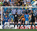 Michail Antonio's lob loops in over keper Scott Gallacher to open the scoring for Sheffield Wednesday