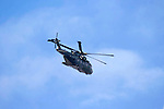 RAF helicopter surveying the scene of the Mid air collision over Kenfig sand dunes near Porthcawl..