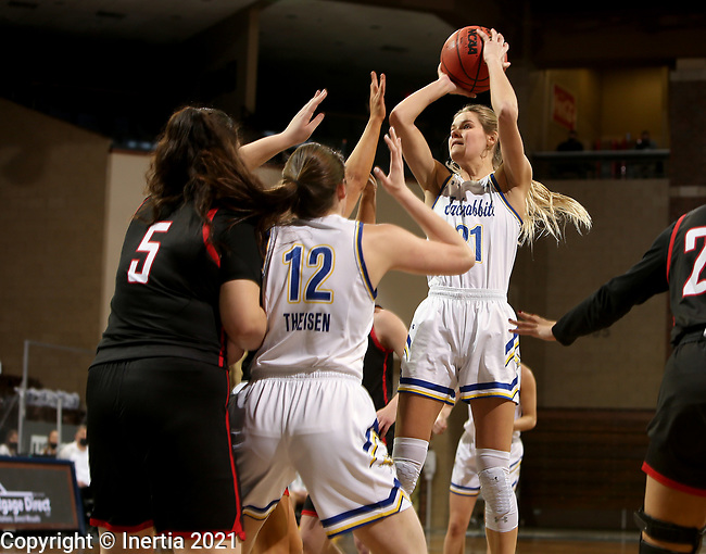 SIOUX FALLS, SD - MARCH 6: Tylee Irwin #21 of the South Dakota State Jackrabbits shoots a jumper against the Omaha Mavericks during the Summit League Basketball Tournament at the Sanford Pentagon in Sioux Falls, SD. (Photo by Dave Eggen/Inertia)
