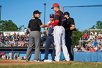 Batavia Muckdogs manager Mike Jacobs (28) shakes hands with base umpire Jennifer Pawol during the lineup exchange with Jerad Head (11) and plate umpire Drew Saluga before a game against the Auburn Doubledays on July 4, 2017 at Dwyer Stadium in Batavia, New York.  Batavia defeated Auburn 3-2.  (Mike Janes/Four Seam Images)
