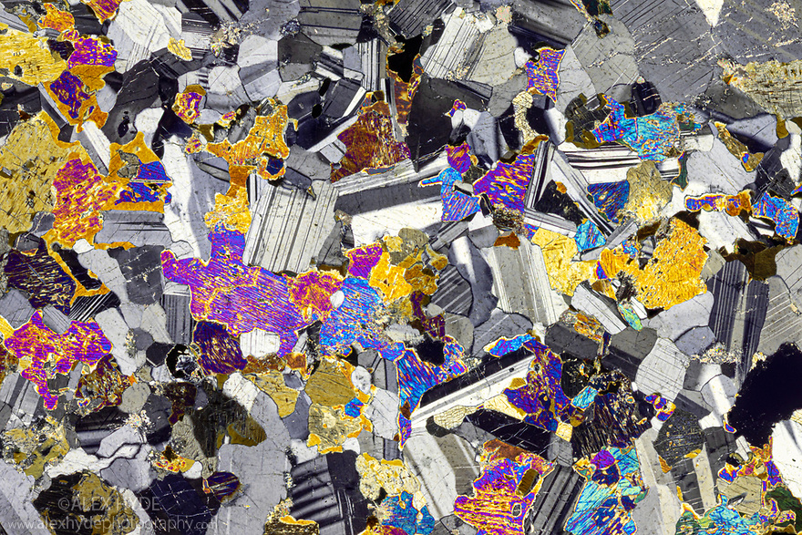 Olivine Gabbro petrographic thin section viewed under cross polarised light. Loch Coruisk, Isle of Skye, Scotland. Focus stacked image.