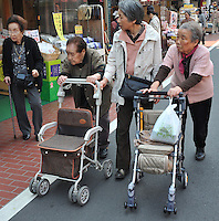 Old people in Sugamo, an area that sells many items especially for old people, Tokyo. A quarter of Tokyo's population will be over 65 in three years time..