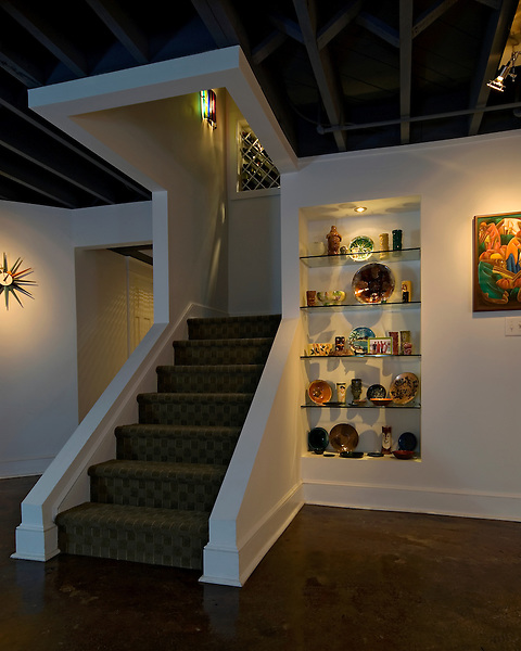 A unique approach to framing a staircase in a modern Richmond basement remodel.
