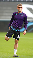 17th October 2020; Liberty Stadium, Swansea, Glamorgan, Wales; English Football League Championship Football, Swansea City versus Huddersfield Town; Cameron Evans of Swansea City stretches during warm up