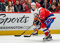 WASHINGTON, DC - JANUARY 31: Radko Gudas #33 of the Washington Capitals  defends against Jordan Eberle #7 of the New York Islanders during a game between New York Islanders and Washington Capitals at Capital One Arena on January 31, 2020 in Washington, DC.